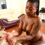 GoGo FukMe strokes a white cock in this interracial handjob picture