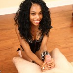 ebony babe gives two handed handjob