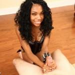ebony babe gives two handed handjob