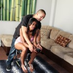 ebony hottie attempting to play video games with her man